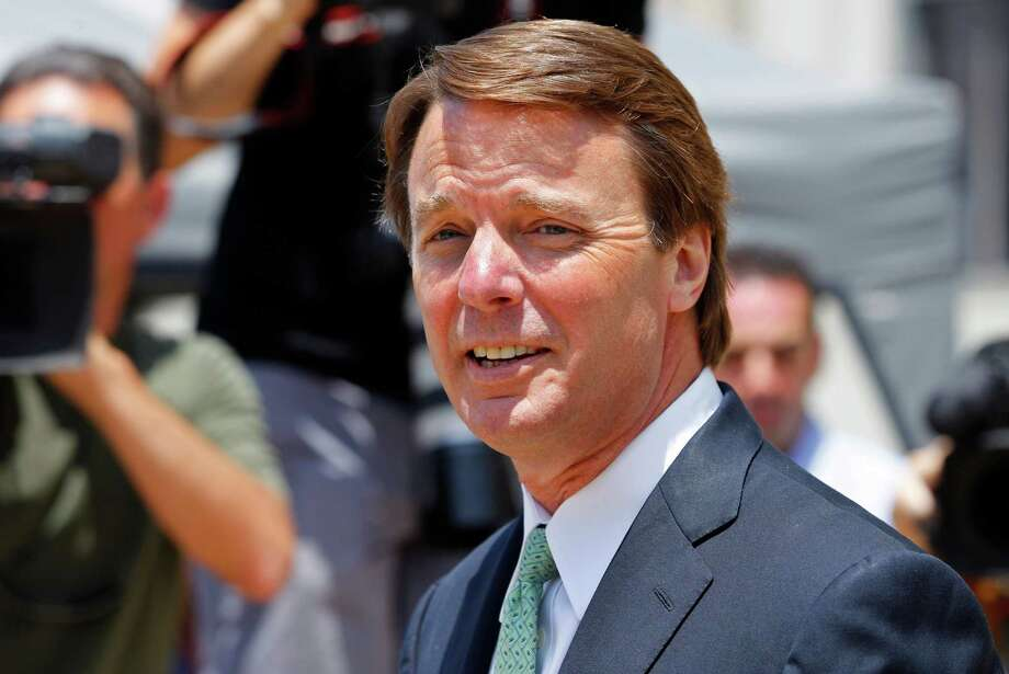 John Edwards leaves a federal courthouse during the ninth day of jury deliberations in his trial on charges of campaign corruption in Greensboro, N.C., Thursday, May 31, 2012. Edwards has pleaded not guilty to six counts related to campaign finance violations over nearly $1 million from two wealthy donors used to help hide the Democrat's pregnant mistress as he sought the White House in 2008. (AP Photo/Chuck Burton) Photo: Chuck Burton / AP