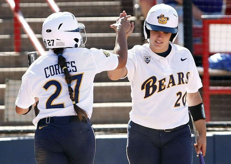 California's Valerie Arioto (20) celebrates with Cheyenne Cordes after scoring in the seventh inning against LSU during a Women's College World Series softball game in Oklahoma City, Thursday, May 31, 2012.  California won 5-3.  (AP Photo/Alonzo Adams) Photo: Alonzo Adams, Associated Press