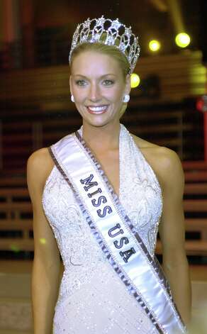 Kandace Krueger, Miss USA 2001, onstage moments after winning the crown. She became the eighth of nine Texans to win the crown. Photo: Patrick Prather, Ho / Miss Universe Organization