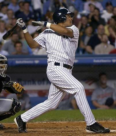 New York Yankees' center fielder Melky Cabrera follows through on a single in the fifth inning against the Cleveland Indians Thursday, July 7, 2005 at Yankee Stadium in New York. It was his first major league hit as the Yankees won 7-2. (AP Photo/Bill Kostroun) Photo: Bill Kostroun, ASSOCIATED PRESS
