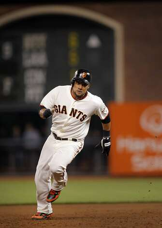 San Francisco Giants left fielder Melky Cabrera rounds second in the eighth inning of their game against the Diamondbacks in San Francisco, Calif. Wednesday, May 30, 2012.  Cabrera tied a Giants record for most hits in a month, 51, with his single in the eighth inning. Photo: Sarah Rice, Special To The Chronicle