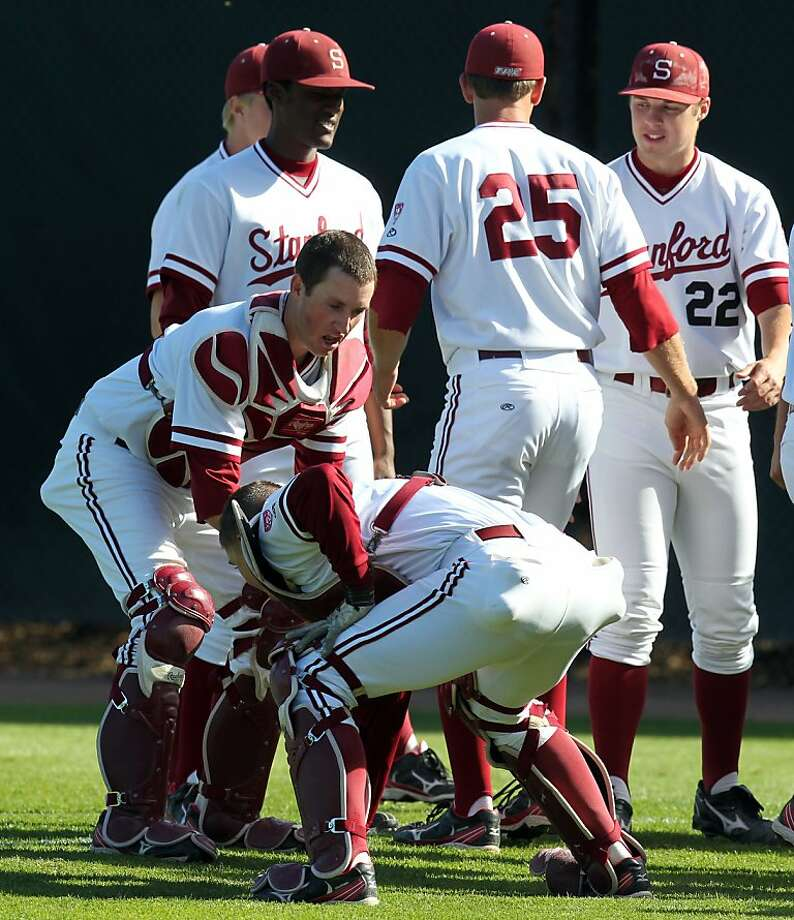 Stanford starting catcher Eric Smith left warms up with teammates prior to the first pitch against the University of California at StanfordÕs Sunken Diamond Friday, May 25, 2012 in Stanford Calif. Photo: Lance Iversen, The Chronicle