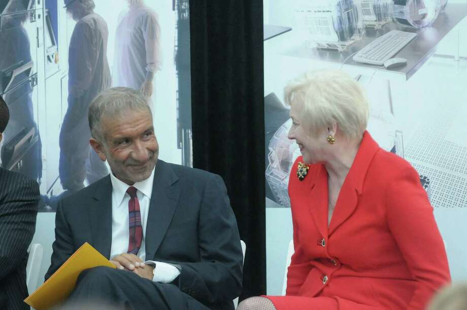 Alain Kaloyeros, left, CNSE Senior Vice President and CEO talks with Nancy  Zimpher, SUNY Chancellor,  during an event at the College of Nanoscale Science and Engineering to announce a new program through the partnership of CNSE, Girls Inc. of the Greater Capital Region and SEFCU, on Thursday, May 31, 2012 in Albany, NY.  The program will be the nation's first nanotechnology based Eureka! program.   (Paul Buckowski / Times Union) Photo: Paul Buckowski / 00017901A