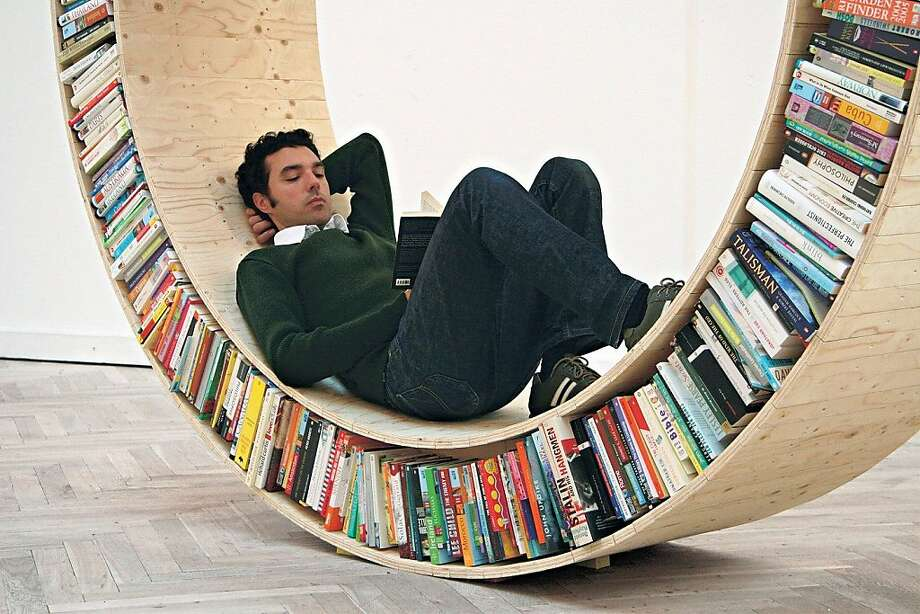 Danish designer David Garcia explores the relationship between human and books in his wooden Archive series where one can sit in a roving circular library that travels wherever the reader wants to go. www.davidgarciastudio.com. Photo: Bookshelf, Thames & Hudson, 2012
