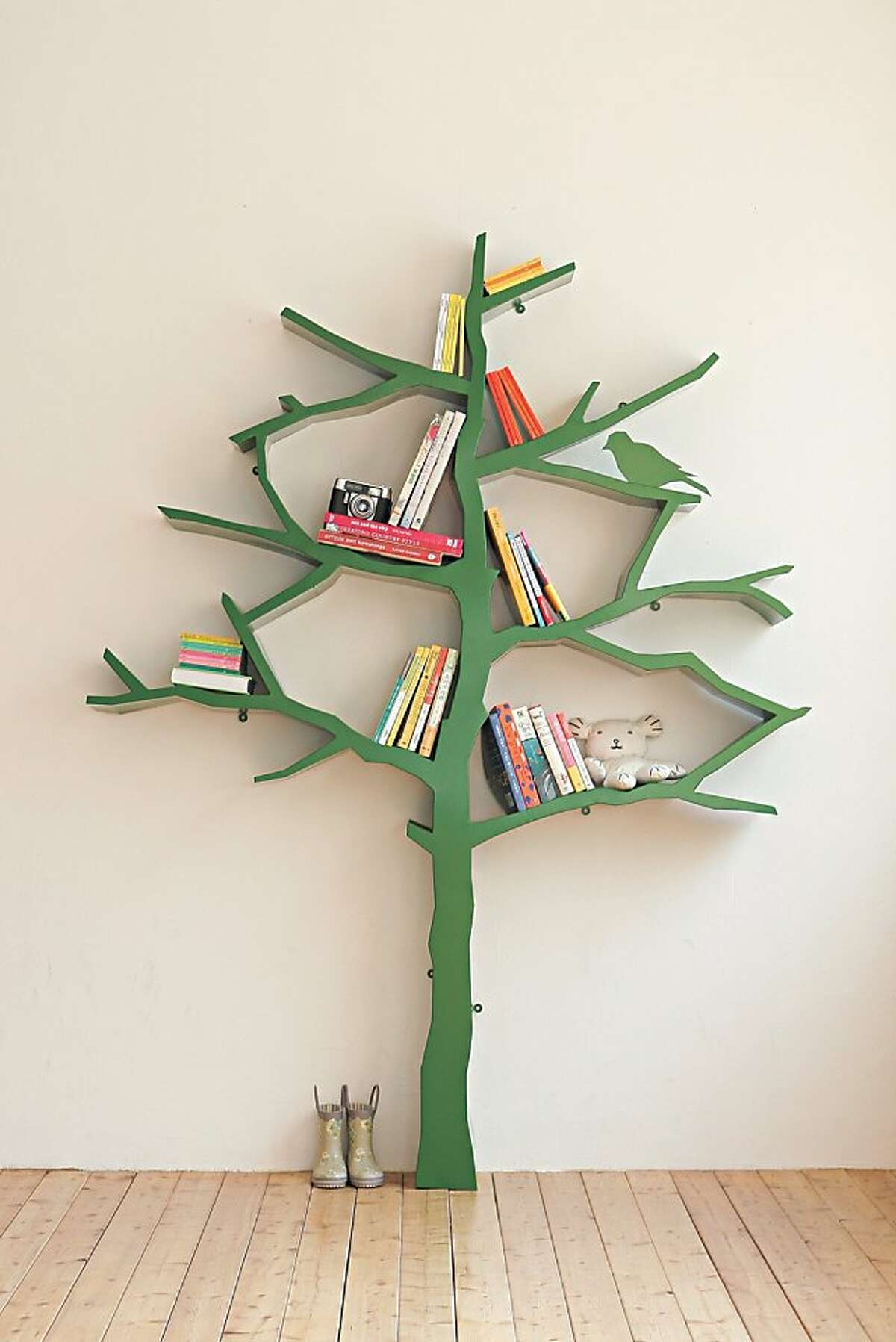 Powder coated steel in a cheery green reminiscent of newly-mown grass forms the Tree bookshelf -- a functional piece of art from Shawn Soh. The bookshelf dynamically changes when books are stacked and/or removed from the tree branches. www.designartist.co.kr.