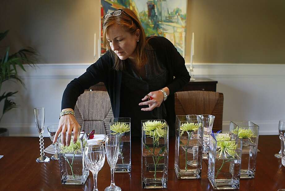 Florist Susan Kelly of Three Sisters Flowers creating a centerpiece for a home tour at a home in Hillsborough, California, on Friday, May 18, 2012.  This centerpiece costs about $100. Photo: Liz Hafalia, The Chronicle