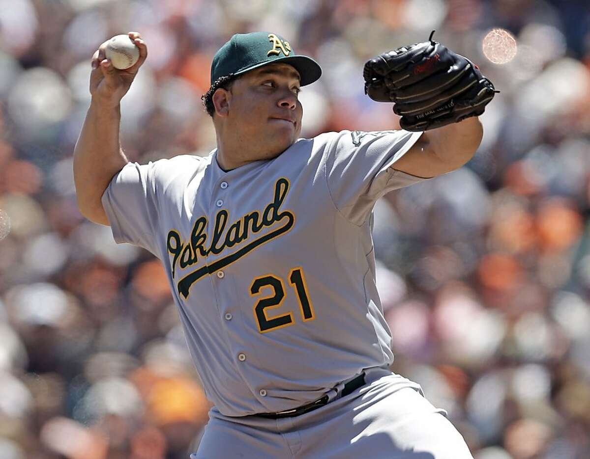Oakland Athletics starting pitcher Bartolo Colon throws to the San Francisco Giants during the first inning of an interleague baseball game in San Francisco, Sunday, May 20, 2012. (AP Photo/Marcio Jose Sanchez)