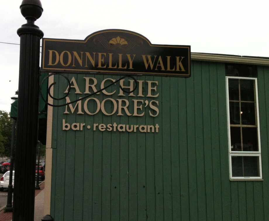 Donnelly Walk, named in honor of Fairfield jewelry store owners murdered on Feb. 2, 2005, is next to Archie Moore's Bar and Restaurant on Sanford Street in downtown Fairfield, part of which the restaurant wants to use for outdoor dining. Photo: Andrew Brophy / Fairfield Citizen contributed
