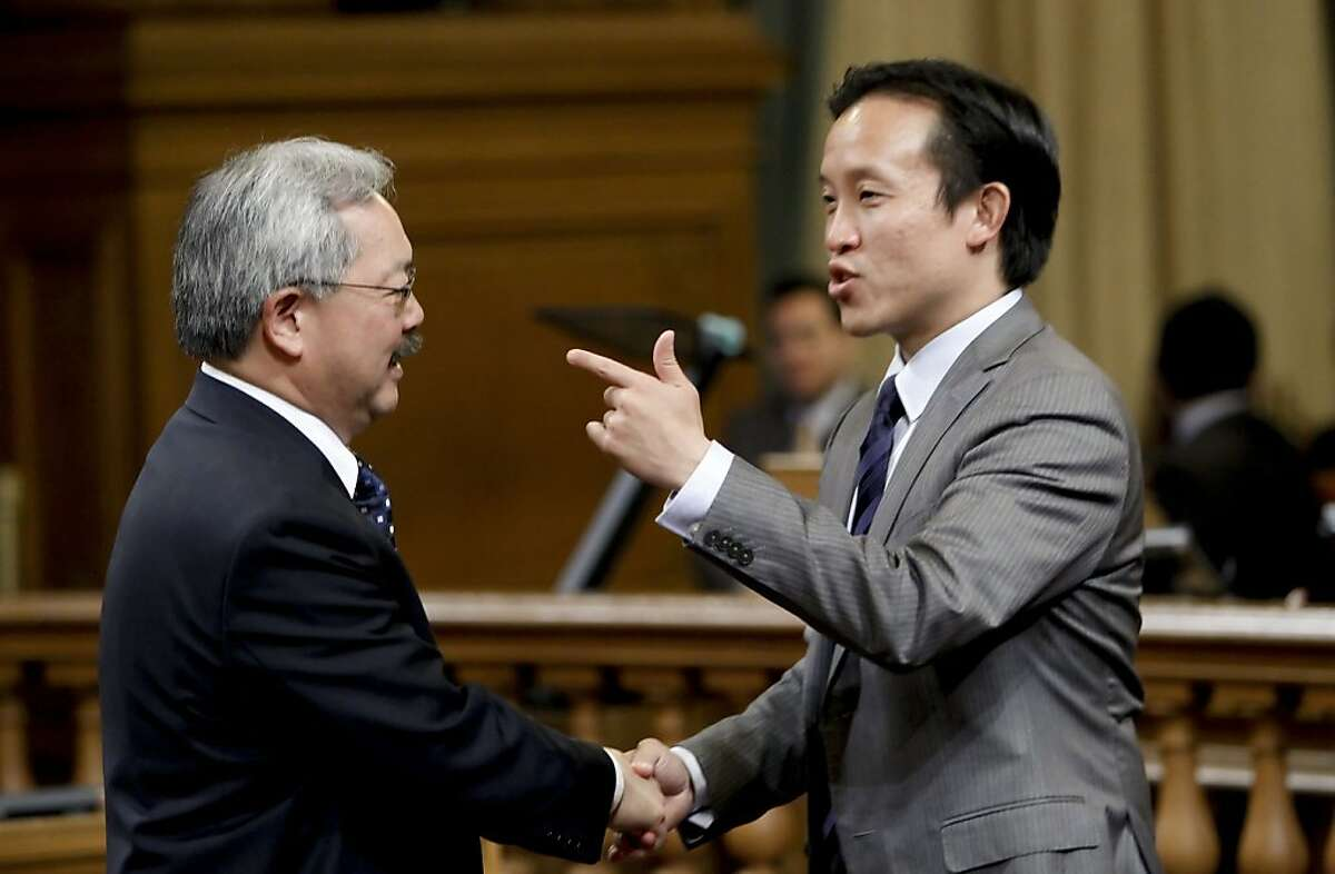 Board of Supervisor's president, David Chiu, (right) greets San Francisco Mayor Ed Lee, as he prepares to present his proposed budget for Fiscal years 2012-2013 and 2013-2014, in the Board of Supervisors chambers on Thursday May 31, 2012, in San Francisco, Ca.