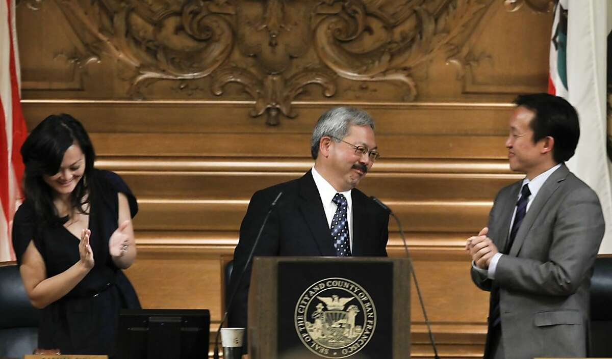 Supervisor's Carmen Chu and David Chiu, applaud San Francisco Mayor Ed Lee, (center) after he presented his proposed budget for Fiscal years 2012-2013 and 2013-2014, in the Board of Supervisors chambers on Thursday May 31, 2012, in San Francisco, Ca.
