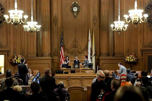Supervisor's Carmen Chu and David Chiu shake hands with San Francisco Mayor Ed Lee, (center) after he presented his proposed budget for Fiscal years 2012-2013 and 2013-2014, in the Board of Supervisors chambers on Thursday May 31, 2012, in San Francisco, Ca.