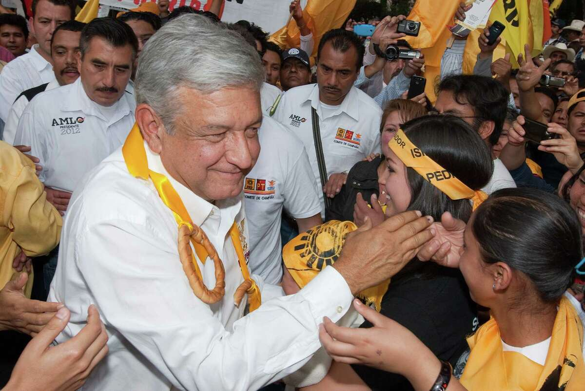 Supporters greet Mexican presidential candidate Andres Manuel Lopez Obrador at a May 9 campaign rally in Tulancingo, Hidalgo. The former mayor of Mexico City saw his lead evaporate in the 2006 race.