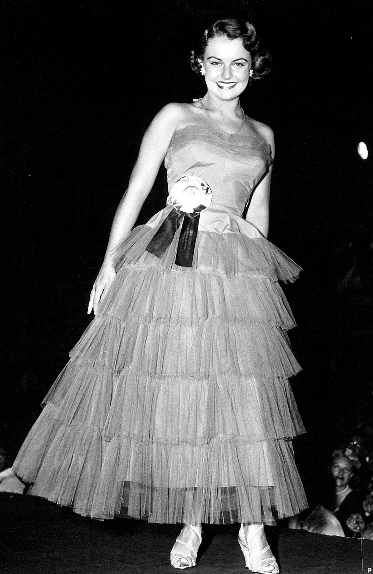 Myrna Hansen of Chicago was just 17 when she was named Miss USA 1953; during judging she donned a green dress she wore at her high school prom. She'd be too young to be in today's pageant.
