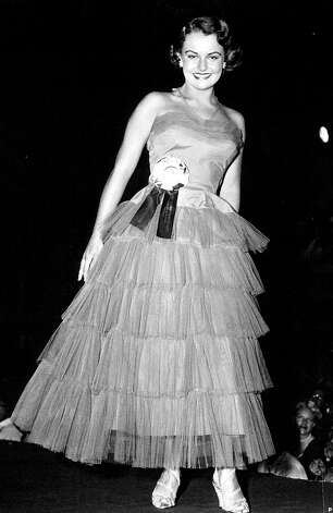 Myrna Hansen of Chicago was just 17 when she was named Miss USA 1953; during judging she donned a green dress she wore at her high school prom. She'd be too young to be in today's pageant. Photo: Miss Universe L.P., LLLP