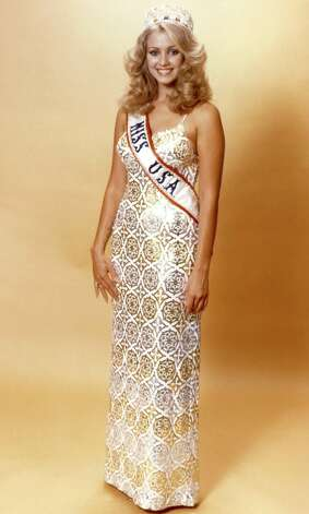 Jineane Ford, Miss USA 1980, poses in an evening gown. Ford took over the crown when Weatherly was named Miss Universe; oddly enough, she is the only Miss Arizona ever to wear the Miss USA sash. Photo: Miss Universe L.P., LLLP