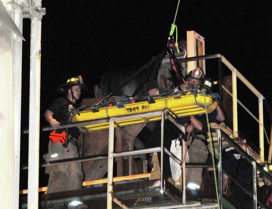 Firefighters rescue a 54-year-old man from a concrete hopper at 39 Front St., Troy, on Thursday, May 31, 2012. The man suffered a shoulder injury and needed treatment at Albany Medical Center Hospital. (Brian Houle / Special to the Times Union)