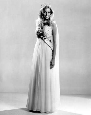 Karen Morrison, Miss USA 1974, poses in the evening gown she wore during the pageant. Photo: Miss Universe L.P., LLLP