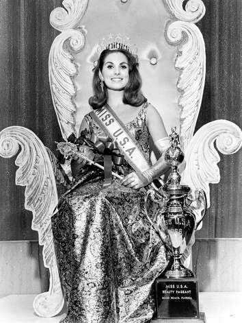 "Maria Remenyi, Miss USA 1966, of El Cerrito, Calif., poses for a photograph immediately after being named Miss USA. The text on the trophy next to her feet reads,  ""Miss U.S.A. Beauty Pageant Miami Beach, Florida."" Photo: Miss Universe L.P., LLLP"