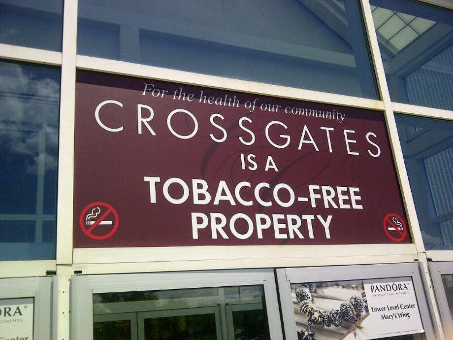 Crossgates Mall and Crossgates Commons in Guilderland and Aviation Mall in Queensbury, three local malls owned by the Pyramid Cos., went smoke free on Friday, May 31, 2012, outlawing use of all tobacco products on mall grounds, inside and out. Security guards handed out pamphlets to shoppers and workers who violated the new edict. (Mark McGuire / Times Union)