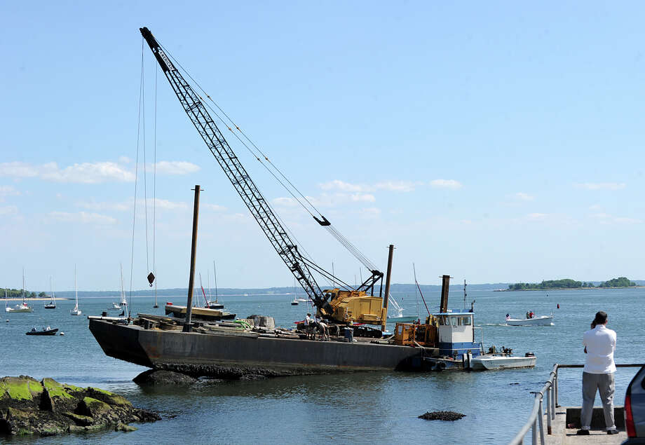 A barge stuck on a rock near the mouth of Greenwich Harbor, Thursday afternoon, May 31, 2012. Photo: Bob Luckey / Greenwich Time