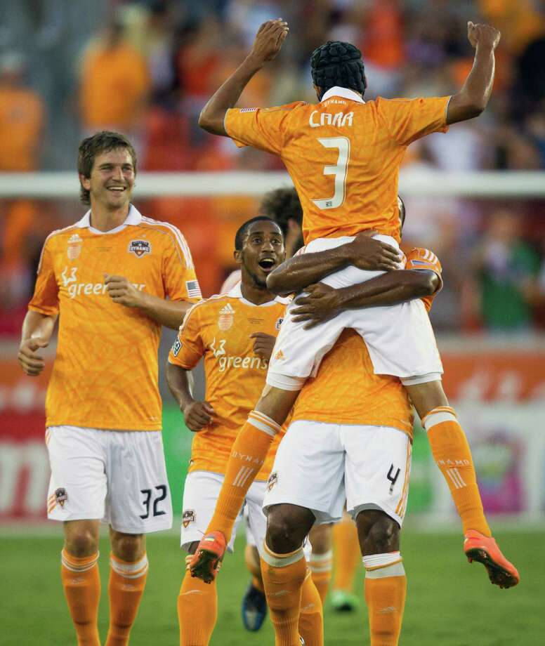 Houston Dynamo forward Galen Carr (3) is lifted by teammate Jermaine Taylor (4) after scoring a goal during first half against Valencia in the BBVA Compass Dynamo Charities Cup friendly soccer match on Thursday, May 31, 2012, at BBVA Compass Stadium in Houston. Photo: Smiley N. Pool, Houston Chronicle / © 2012  Houston Chronicle