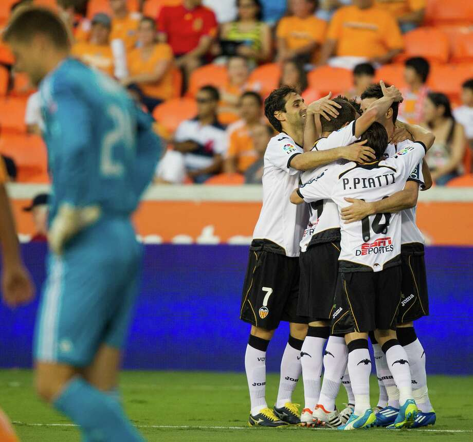 Houston Dynamo goalkeeper Tyler Deric looks away as Valencia players celebrate a goal by forward Aritz Aduriz during first half of the BBVA Compass Dynamo Charities Cup friendly soccer match on Thursday, May 31, 2012, at BBVA Compass Stadium in Houston. Photo: Smiley N. Pool, Houston Chronicle / © 2012  Houston Chronicle