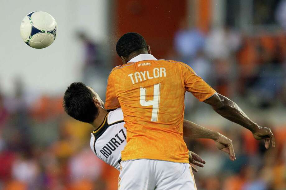 Valencia forward Aritz Aduriz (11) is hit in the neck by Houston Dynamo defender Jermaine Taylor (4) for a foul during first half of the BBVA Compass Dynamo Charities Cup friendly soccer match on Thursday, May 31, 2012, at BBVA Compass Stadium in Houston. Photo: Smiley N. Pool, Houston Chronicle / © 2012  Houston Chronicle