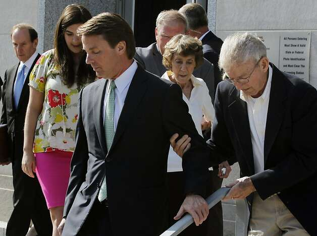 Former Sen. John Edwards helps his father, Wallace, down the stairs of the federal courthouse at the end of his trial n Greensboro, North Carolina, Thursday, May 31, 2012. Edwards was found not guilty on one of six counts in his campaign finance trial and announced it could not agree on the five remaining counts. (Chucky Liddy/Raleigh News & Observer/MCT) Photo: Chuck Liddy, McClatchy-Tribune News Service