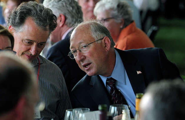Interior Secretary Ken Salazar talks with symposium Co Chair William Dupont at his table before addressing a large group of symposium attendees on the grounds of the San Antonio landmark to consider World Heritage Site nomination on May 31, 2012. Photo: Tom Reel, San Antonio Express-News / ©2012 San Antono Express-News