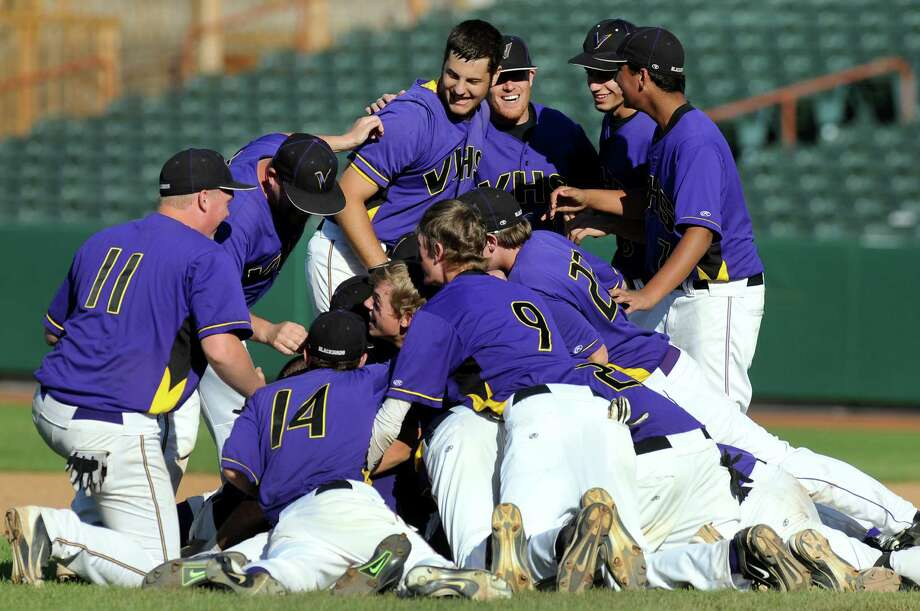 Voorheesville teammates pile onto the infield to celebrate their 6-1win over Hoosick Falls in the Class C final baseball game on Thursday, May 31, 2012, at Joseph L. Bruno Stadium in Troy, N.Y. (Cindy Schultz / Times Union) Photo: Cindy Schultz / 00017857A