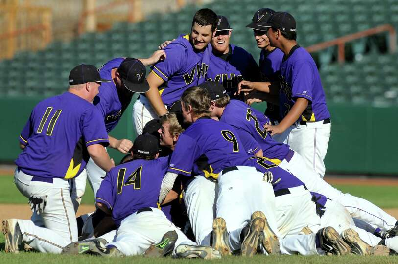 Voorheesville teammates pile onto the infield to celebrate their 6-1win over Hoosick Falls in the Cl