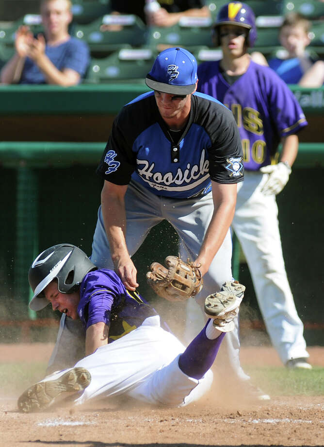 Voorheesville's J.D. Springer (24) is safe at home when Hoosick Falls's pitcher Cody LaFlamme (44) drops the ball during their Class C final baseball game  on Thursday, May 31, 2012, at Joseph L. Bruno Stadium in Troy, N.Y.  (Cindy Schultz / Times Union) Photo: Cindy Schultz / 00017857A