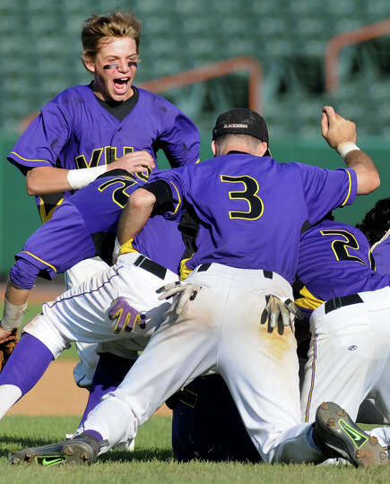Voorheesville's Zach Childs, left, joins his team on the infield to celebrate their 6-1win over Hoos