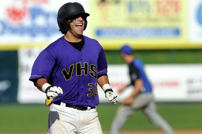 Voorheesville's Mike Chiseri (32) grins on his way to third base after hitting a triple during their