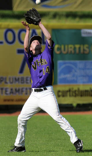 Voorheesville's Ryan Clayton (14) catches a fly to left field during their Class C final baseball ga