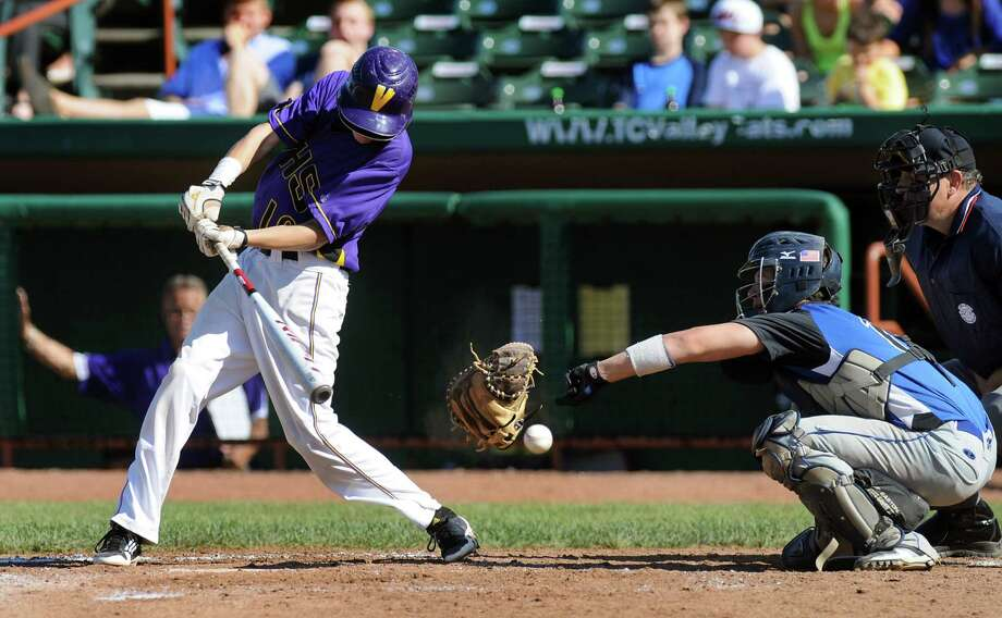 A swing from Voorheesville's Zach Childs (10), left, hits the glove of Hoosick Falls's catcher Logan Brogue (12) during their Class C final baseball game  on Thursday, May 31, 2012, at Joseph L. Bruno Stadium in Troy, N.Y. Interference on Brogue was called and Childs went to first. (Cindy Schultz / Times Union) Photo: Cindy Schultz / 00017857A