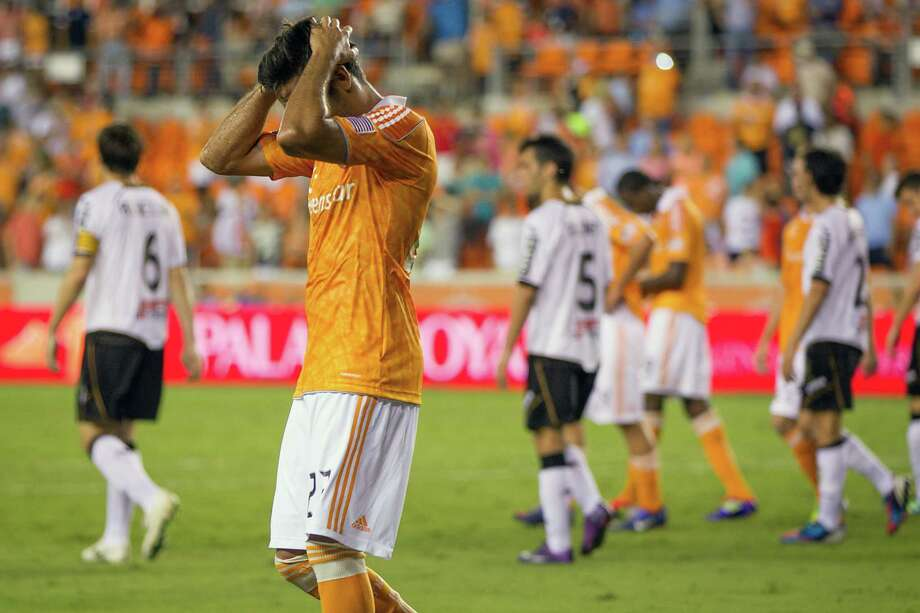 Houston Dynamo defender Oscar Recio reacts as time expires on the BBVA Compass Dynamo Charities Cup friendly soccer match on Thursday, May 31, 2012, at BBVA Compass Stadium in Houston. Valencia won the game 2-1. Photo: Smiley N. Pool, Houston Chronicle / © 2012  Houston Chronicle