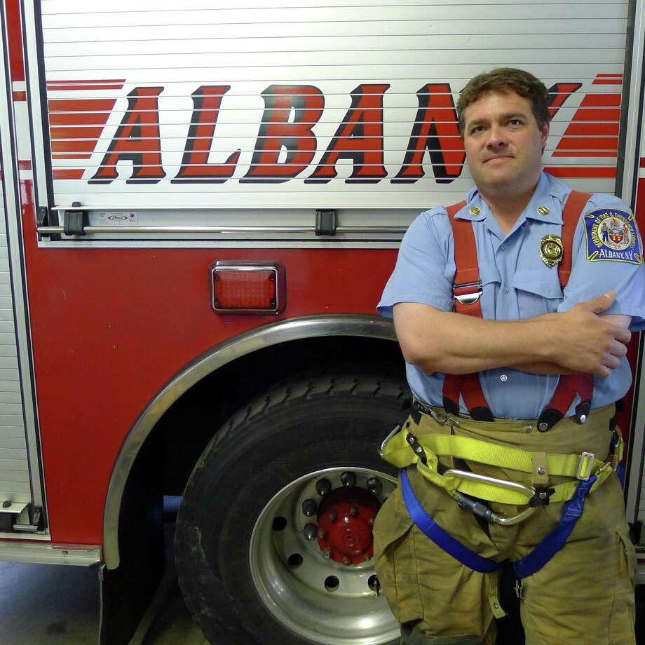 Paramedic and firefighter Capt. Geo Henderson saved a 25-year-old man who had a SUV pinned to his chest after a jack failed when he tried to find the source of an oil leak in Albany N.Y. Thursday May 31, 2012. (Michael P. Farrell/Times Union) Photo: Michael P. Farrell / 00017902A