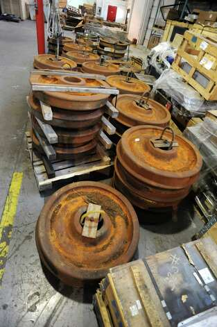 Unused train wheels for never-used bullet train cars at a warehouse on Thursday, May 31, 2012 in Rotterdam, N.Y. (Lori Van Buren / Times Union) Photo: Lori Van Buren