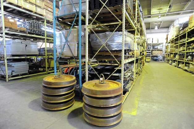 Unused train wheels and shelves of unused parts for never-used bullet train cars at a warehouse on Thursday, May 31, 2012 in Rotterdam, N.Y. (Lori Van Buren / Times Union) Photo: Lori Van Buren