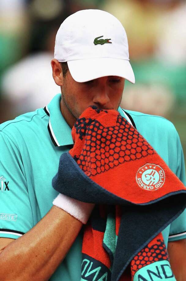 PARIS, FRANCE - MAY 31:  John Isner of USA looks dejected in his men's singles second round match against Paul-Henri Mathieu of France during day 5 of the French Open at Roland Garros on May 31, 2012 in Paris, France.  (Photo by Matthew Stockman/Getty Images) Photo: Matthew Stockman / 2012 Getty Images