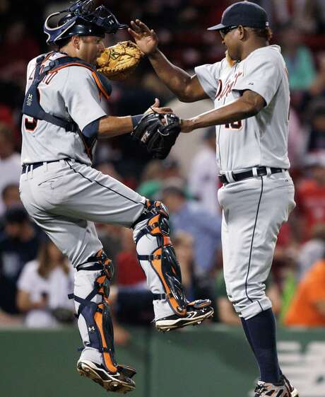 Tigers catcher Gerald Laird, left, and closer Jose Valverde celebrate after the Tigers defeated the Red Sox 7-3 at Fenway Park on Thursday. Photo: Charles Krupa / AP