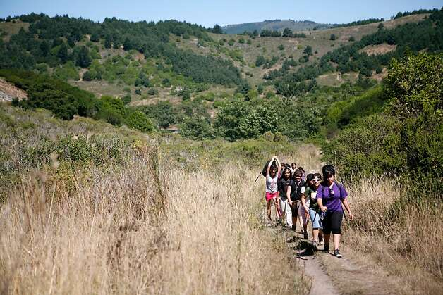 A group of seventh grade students from the Urban Promise Academy hike toward the beach at Point Reyes National Seashore in Marin County, Calif. on Thursday September 2, 2010. Each year the entire seventh grade class of the Urban Promise Academy, a middle school located in the Fruitvale neighborhood of Oakland goes on a three day trip to the Point Reyes National Seashore where many students go camping and hiking for the first time in their lives. The Urban Promise Academy received outdoor gear-including hiking backpacks, hiking shoes, and gloves- as well as outdoor training from Bay Area Wilderness Training, an organization headquartered in Oaklan with the mission of providing at risk urban youth first hand experience in the wilderness. Bay Area Wilderness Training, or BAWT, grants full access to its gear library to those schools and organizations who complete its wilderness training program. Photo: Jasna Hodzic, The Chronicle