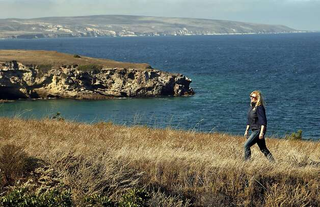 Nita Vail walks along an ocean view bluff at the storied Vail & Vickers Ranch, on the 84-square mile Santa Rosa Island, California, November 1, 2011. The great-granddaughter of the rancher who, with a partner, bought the island in 1901 spends time at the ranch before the December 31, 2011 date, which will mark the end of the Vail & Vickers occupancy on the island. Photo: Al Seib, MCT