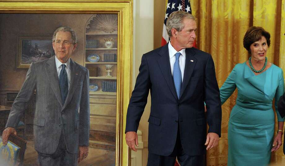 Former President George W. Bush and first lady Laura Bush, right, attend the official unveiling of their portraits at the White House in Washington, D.C., Thursday, May 31, 2012. (Olivier Douliery/Abaca Press/MCT) Photo: Olivier Douliery / Abaca Press
