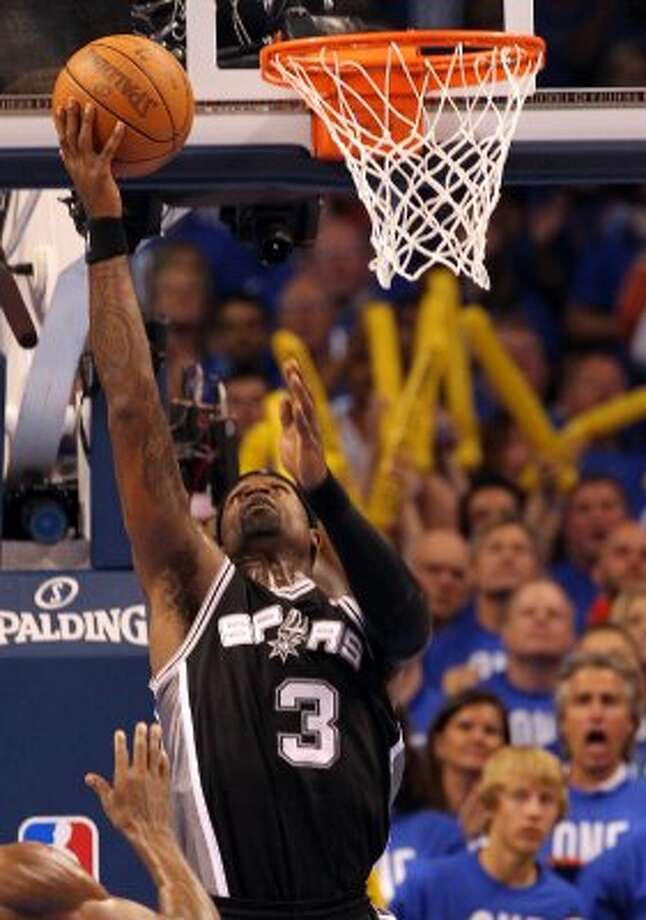 San Antonio Spurs' Stephen Jackson (3) scores a basket during the second half of game three of the NBA Western Conference Finals in Oklahoma City, Okla. on Thursday, May 31, 2012. (Kin Man Hui / Kin Man Hui / San Antonio Express-News)