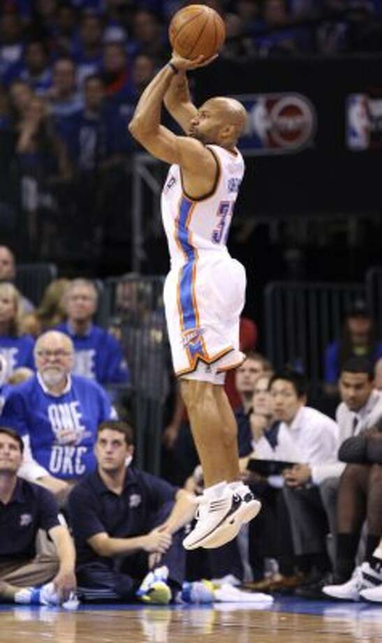 Oklahoma City Thunder's Derek Fisher (37) shoots a three point basket during the second half of game three of the NBA Western Conference Finals in Oklahoma City, Okla. on Thursday, May 31, 2012. (Edward A. Ornelas / Edward A. Ornelas / San Antonio Express-News)