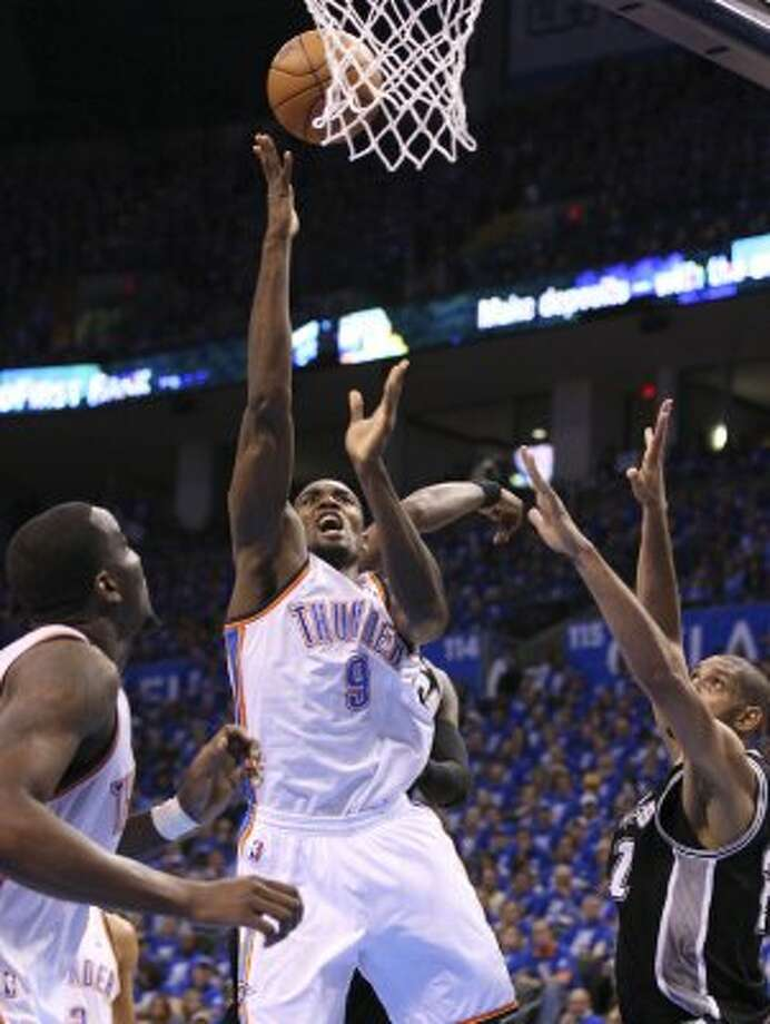 Oklahoma City Thunder's Serge Ibaka (9) shoots the ball during the first half of game three of the NBA Western Conference Finals in Oklahoma City, Okla. on Thursday, May 31, 2012. (Edward A. Ornelas / Edward A. Ornelas / San Antonio Express-News)