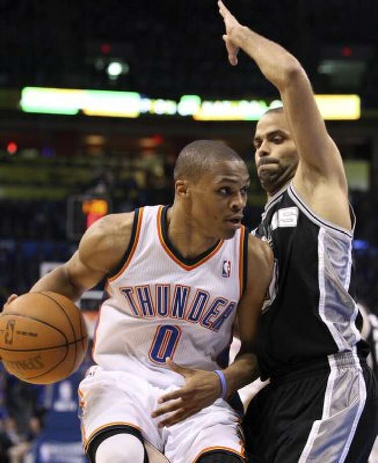 Oklahoma City Thunder's Russell Westbrook (0) dribbles against San Antonio Spurs' Tony Parker (9) during the first half of game three of the NBA Western Conference Finals in Oklahoma City, Okla. on Thursday, May 31, 2012. (Edward A. Ornelas / Edward A. Ornelas / San Antonio Express-News)