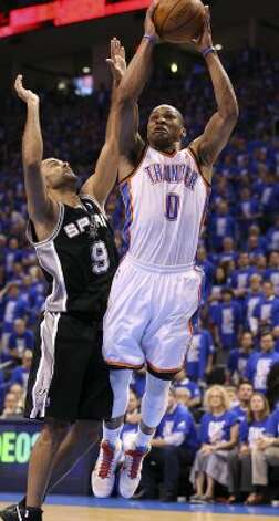 Oklahoma City Thunder's Russell Westbrook (0) shoots against San Antonio Spurs' Tony Parker (9) during the first half of game three of the NBA Western Conference Finals in Oklahoma City, Okla. on Thursday, May 31, 2012. (Edward A. Ornelas / Edward A. Ornelas / San Antonio Express-News)